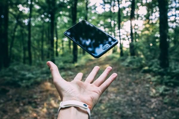 Photo by Stanislav Kondratiev on Unsplash throwing iphone in forest
